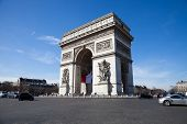 picture of charles de gaulle  - Arc de Triomphe with French flag hanging from vaulted ceiling inside the arch - JPG