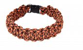 stock photo of paracord  - Paracord survival Bracelet using a Cobra weave in a leopard pattern cord - JPG