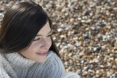 pic of herne bay beach  - Closeup of thoughtful young woman looking away at beach - JPG