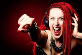 image of dreadlocks  - Expressive girl rock singer with great red dreadlocks - JPG