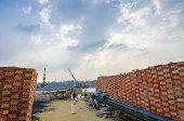Man Carrying A Basket Of Rice Husk, Brick Kiln Factory, Cloud Sky With Rays, Mekong Delta, Vietnam