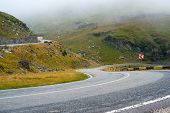 foto of slippery-roads  - Serpentine road in the mountains of Romania - JPG
