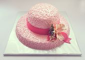 pic of fancy cakes  - Birthday cake looks like hat in pink color and flower made of sugar.