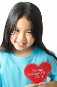 Color photo of a 7 year old asian black haired girl holding an heart-shaped
