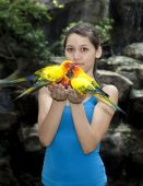 Female Teenager With Sun Conure
