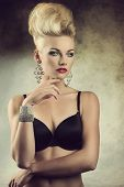 stock photo of aristocrat  - sexy portrait of charming young girl posing with aristocratic expression creative hair - JPG