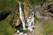 stock photo of enticing  - Beautiful waterfall in cloud forest near Banos one of Ecuadors most enticing and popular tourist destination - JPG