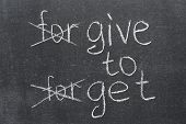 stock photo of forgiveness  - forgive to forget transformed to the give to get phrase on the blackboard - JPG