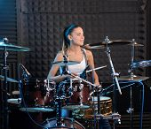 stock photo of drum-set  - Girl behind drum - JPG