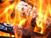 stock photo of ember  - Wood embers crack in a hot fire - JPG