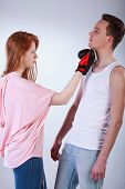 foto of rude  - Rude girl beating her friend with boxing gloves - JPG