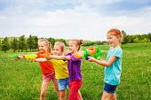 Постер, плакат: Four children playing with water guns