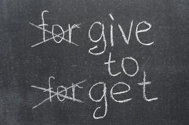 foto of transformation  - forgive to forget transformed to the give to get phrase on the blackboard - JPG