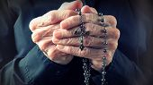 picture of repentance  - Hands of an elder woman holding a rosary while prayingChristian daily devotional of a worshiper relationship with God the Creator and Savior - JPG