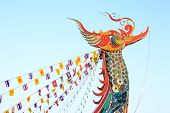 pic of hamsa  - Tip of boat was decorated to swan shape and Flags in evening at Golden Triangle  - JPG