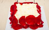 picture of fancy cake  - whipped cream mango cake with red rose petals  - JPG