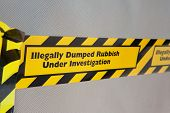 pic of dump  - An illegally dumped item marked with warning tape - JPG