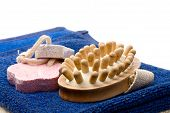 foto of pumice-stone  - Towels brush and pumice stones in closeup - JPG