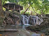 stock photo of kan  - Waterside pavilion at Wang Kan Lueang Waterfall - JPG