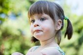 stock photo of stubborn  - Sulky angry young girl child sulking and pouting - JPG