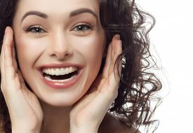image of lip  - closeup portrait of attractive  caucasian smiling woman brunette isolated on white studio shot lips toothy smile face hair head and shoulders looking at camera tooth - JPG