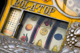 foto of poker machine  - Old vintage slot machine close up view - JPG