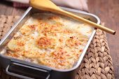 pic of baked potato  - Potatoes a la dauphinoise in a baking dish - JPG