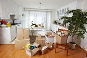 foto of movers  - Moving boxes in new house - JPG