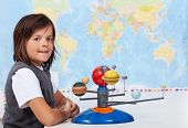 image of earth mars jupiter saturn uranus  - Young boy in school learning about the solar system - JPG