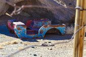 stock photo of chassis  - auto chassis abandoned in the ruins of a mining town - JPG