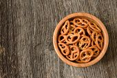 image of pretzels  - Bowl of crunchy pretzels with side light - JPG