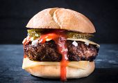 pic of beef-burger  - Big beef burger with cheese and onionclose up and selective focus - JPG