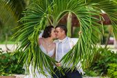 image of married  - young loving couple on tropical sea background  - JPG