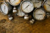 foto of pressure vessel  - Old pressure gauge or damage pressure gauge of oil and gas industry on wooden background - JPG