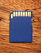 picture of memory stick  - Blue compact memory card for camera in closeup - JPG