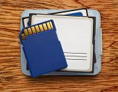 stock photo of memory stick  - Blue compact memory cards for camera on wooden background - JPG