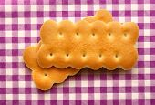 picture of lilas  - Fresh cookies on lila checked background closeup - JPG