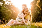 picture of caress  - Mother is cuddling her worried child outdoor in nature - JPG