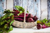picture of wooden basket  - Fresh organic beetroot with green leaves in a basket - JPG