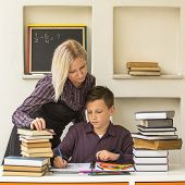 image of tutor  - Young student learns at home with a his tutor - JPG