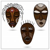 stock photo of african mask  - The set of three African masks in color - JPG