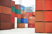 foto of loading dock  - Stack of freight container boxes after sorting in warehouse dock terminal of cargo sea port - JPG