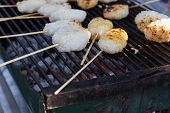 stock photo of brazier  - sticky rice with skewer are roasting on charcoal brazier - JPG