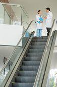 stock photo of escalator  - Medical colleagues on the top of escalator - JPG