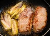 stock photo of endive  - Cooked beef tenderloins with endives in a pan - JPG