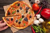 pic of take out pizza  - Unrecognizable man hand taking sliced piece of italian pizza margherita with tomatoes - JPG