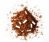 picture of tobacco leaf  - Pile of tobacco leaves with broken cigarettes and no filters isolated on a white background - JPG