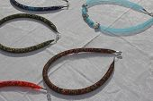 picture of flea  - many colorful handmade necklaces for sale at flea market - JPG