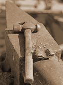 picture of anvil  - heavy ANVIL and sturdy HAMMER in the blacksmith - JPG