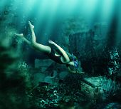 picture of chest  - Woman with mask and snorkel diving swimming underwater among the ancient ruins to chest - JPG